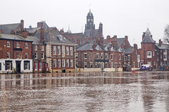 Flooded buildings. Alongside a river Royalty Free Stock Photography