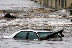 Flooded Car. A car caught in a flood and swept away in the raging water royalty free stock image