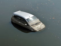 Flooded Car. Abandoned Car in a Flooded Parking Lot royalty free stock photos