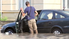 Flooded car. European city flooded after a heavy rain stock video footage
