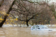 Flooded car during a stormy weather Stock Photography