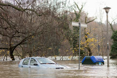 Flooded car during a stormy weather Stock Photos