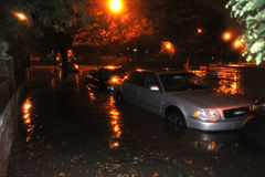 Flooded cars, caused by Hurricane Sandy. BROOKLYN, NY - OCTOBER 29: Flooded cars, caused by Hurricane Sandy, are seen on October 29, 2012, in the corner of Royalty Free Stock Photography