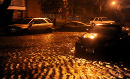 Flooded cars, caused by Hurricane Sandy. BROOKLYN, NY - OCTOBER 29: Flooded cars, caused by Hurricane Sandy, are seen on October 29, 2012, in the corner of Stock Photography