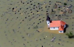 Flooded church and graveyard. Aerial view of flooded Catholic church and graveyard Stock Image
