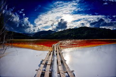 Flooded church in toxic red polluted  lake due to copper mining, Royalty Free Stock Image