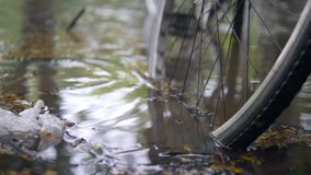 Flooded City Road After Heavy Storm. Bicycle Parked in Deep Waters. Rain Season in Asia. 4K. stock video footage