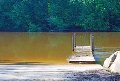 Flooded dock. At a boat launch in Grand Rapids Michigan royalty free stock image