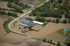 Flooded factory. Aerial view of flood waters and a flooded factory Royalty Free Stock Photos