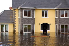 Flooded Family Home. A beautiful modern family home, deep in flood waters royalty free stock photography