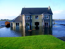 Flooded Family Home. A beautiful modern family home, deep in flood waters royalty free stock images