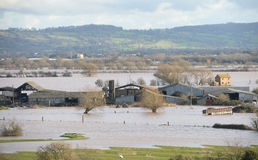 Flooded farm buildings  Royalty Free Stock Images