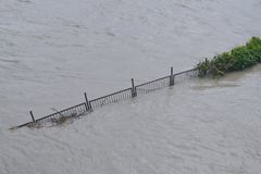 Flooded fence. Fence drown under a floodwater, during floodings on June 2013 in Bratislava, Slovakia of the Danube river Stock Photo