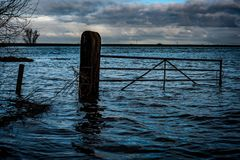 Flooded fenland gateway in winter Royalty Free Stock Photos