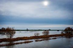 Flooded fenland habitats. Fenland flooding across washland fields in winter Stock Image
