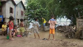 Flooded, Fishing, Kids,  mekong, cambodia, southeast asia stock video