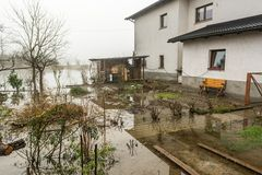 Flooded gardens. House with its gardens flooded after spring thaw Royalty Free Stock Image