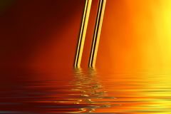 Flooded Gold Wire. Gold wire dipping into water on the horizon Royalty Free Stock Image