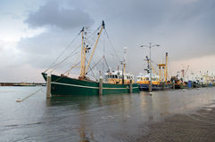 Flooded harbour. Cutters in a harbour flooded at extreme high tide in the nethrlands Stock Image
