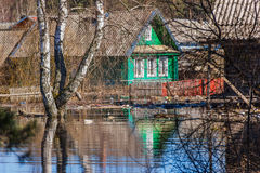 Flooded homes. Spring flood. Maksatikha 2013. Volchina river overflowed. Spring flood. Tver region stock images