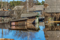 Flooded homes. Spring flood. Maksatikha 2013. Volchina river overflowed. Spring flood. Tver region stock image