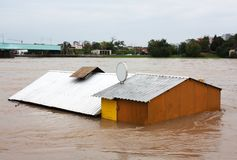 Flooded house. Shot of flooded house. Harmful influence of the river stock photos
