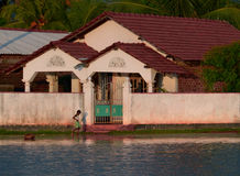 Flooded House. Child Plays in front of a Flooded House in Chilaw, Sri Lanka stock images