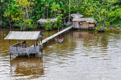 Flooded house and a family on the Amazon River, Brazil Royalty Free Stock Image
