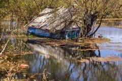 Flooded house. Lashihai lake, Yunnan Province, China Royalty Free Stock Images