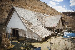 Flooded house in marshy bog royalty free stock photography