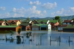 Flooded houses by the river. After rains royalty free stock photo