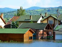 Flooded houses by the river. After the rains stock photos
