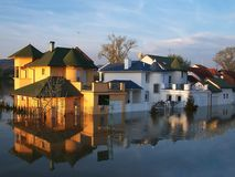 Flooded houses by the river after the rains. Reflection of flooded houses by the river after the rains royalty free stock photos
