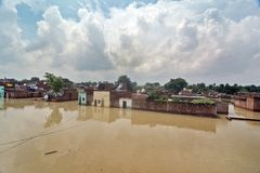 Flooded India. Flood water continues to rise in Uttar Pradesh, where the situation continued to remain grim with the swollen rivers inundate thousands of Stock Photography