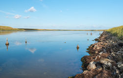 Flooded land and an eroded clay wall Stock Images