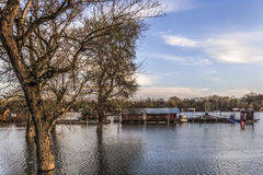 Flooded Land With Floating Houses At Sava River - New Belgrade - Serbia. Early spring photograph shot at dusk of risen Sava river water level, with floating Royalty Free Stock Photography