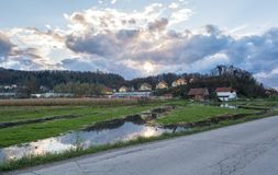 Flooded land in front of houses Royalty Free Stock Photos