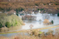 Flooded landscape. Landscape of luxury homes and farmland under River Thames floodwater near Windsor, UK stock photo