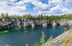 Flooded marble quarry. Visible gallery. Stock Photos