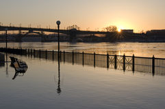 Flooded Mississippi River in downtown Saint Paul. At the shores of flooded Mississippi River in downtown Saint Paul Minnesota at sunrise royalty free stock images