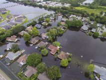 Flooded Neighborhood Corner in Sarasota, FL. Flooding after heavy rains in north Sarasota, Florida, in 2017, with less affect houses in the upper left royalty free stock photography
