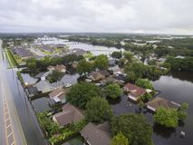 Flooded Neighborhood and Road in Sarasota, FL. Flooding after heavy rains in north Sarasota, Florida, in 2017, with a dry road to the left stock photography