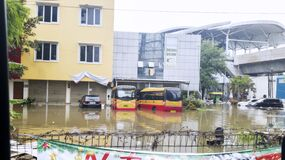 Flooded office buildings and buses in Jakarta city