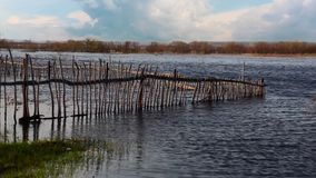 Flooded Old Wooden Fence. Stock Photography