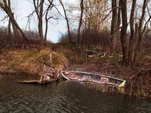 Flooded old wooden row boat on river royalty free stock photography