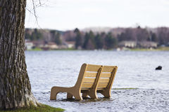 Flooded park bench Stock Photos