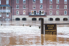 Flooded pavement at the riverside in York, UK Stock Images