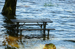 Flooded picnic table Royalty Free Stock Images