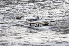 Flooded picnic table Stock Photography