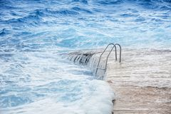 Flooded pool area. Natural disaster rage on the beach Royalty Free Stock Photography